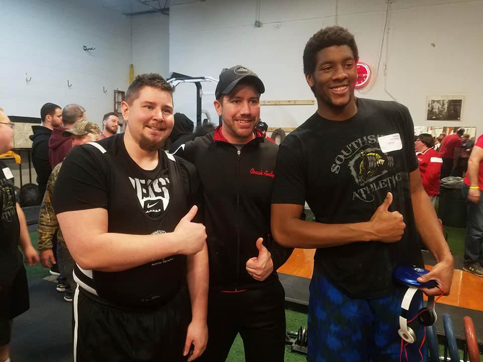 Andy Cameron and athletes after weightlifting competition